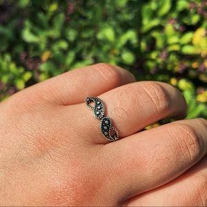 silver swirly ring